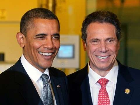 former president barack obama standing next to new york governor andrew cuomo