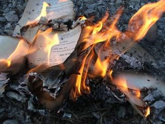 a book being burned as a form of censorship