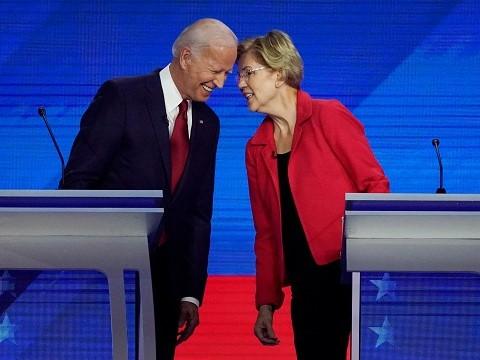 joe biden touching foreheads with elizabeth warren after a democratic debate
