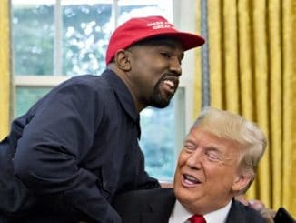 kanye west wearing a maga hat in the oval office while hugging donald trump