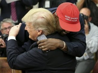 kanye west in a red maga hat hugging donald trump
