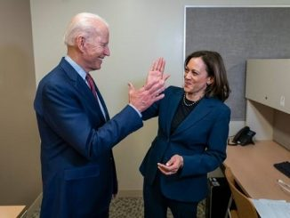 joe biden and vp selection kamala harris high fiving in a break room