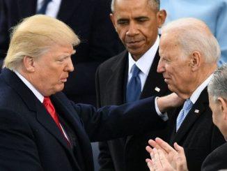 president trump with his hand on joe biden's shoulder