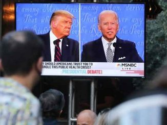 Trump and Biden on screen during debate