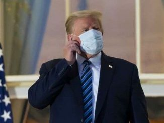 Trump removes mask