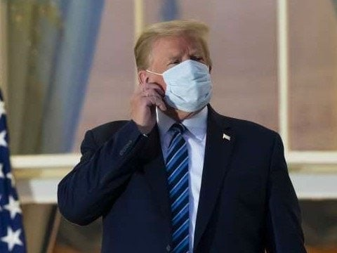 Trump removes mask