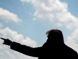 Trump points to the sky