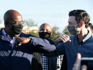 raphael warnock and jon ossoff bumping elbows in covid masks