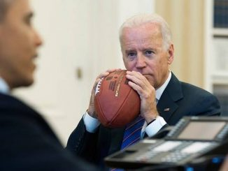 joe biden eating a football